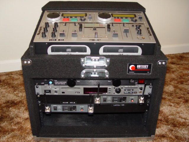 This system is used for Ceremonies,and includes: Dual CD Players, 1 Mini Disc Player, 1 Hand Held Mic & 1 lavalier Mic